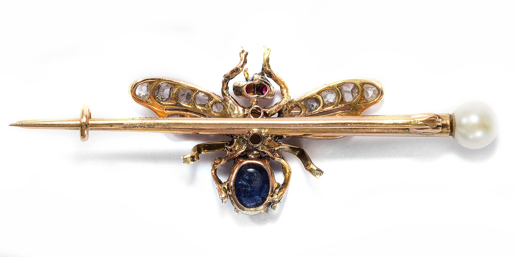 eine goldene fliege aus diamanten saphir rubin perlen. Black Bedroom Furniture Sets. Home Design Ideas